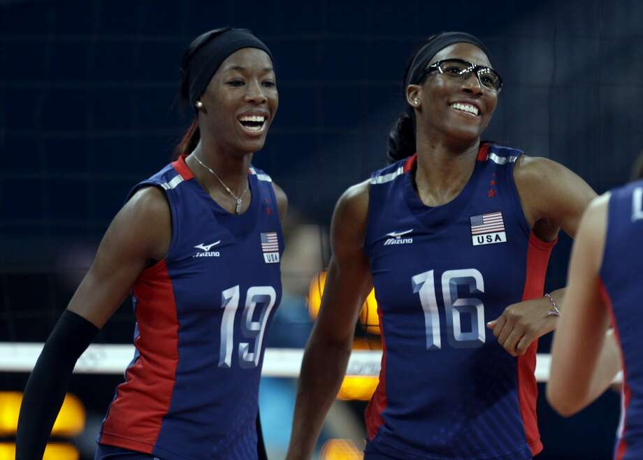 United States' Destinee Hooker, left, and Foluke Akinradewo celebrate during a women's preliminary volleyball match against Serbia at the 2012 Summer Olympics, Friday, Aug. 3, 2012, in London. (AP Photo/Jeff Roberson) (Associated Press)