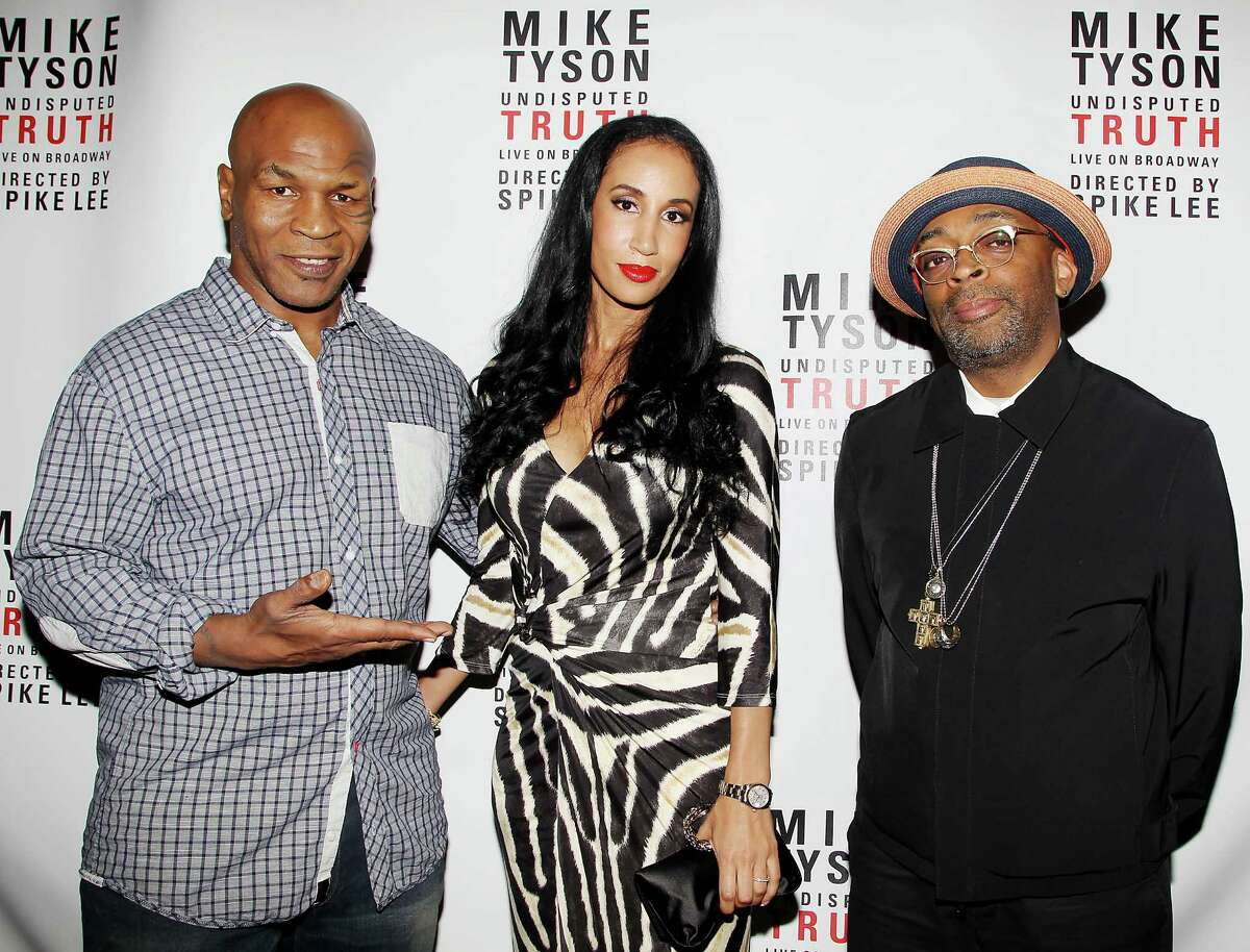 This image released by Starpix shows, from left, former boxer Mike Tyson, his wife Kiki Tyson and director Spike Lee posing backstage after the curtain call for the opening night of