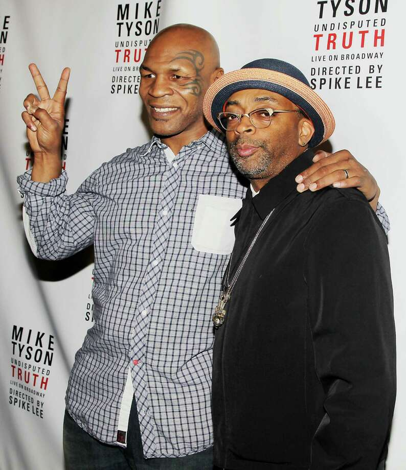 "This image released by Starpix shows, former boxer Mike Tyson, left, and Spike Lee pose backstage after the curtain call on the opening night of ""Mike Tyson: Undisputed Truth,"" Thursday, Aug. 2, 2012 at the Longacre Theatre in New York.  The one man show starring Tyson was directed by Spike Lee, and written by Tyson's wife Kiki. (AP Photo/Starpix, Amanda Schwab) Photo: Amanda Schwab"