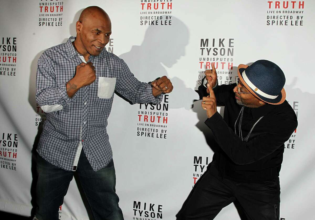 Former boxer Mike Tyson, left, and director Spike Lee pose backstage at the
