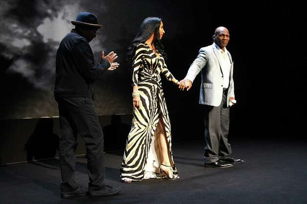 "Director Spike Lee, left, Lakiha Tyson, center, and her husband and former boxer Mike Tyson takes part in a curtain call following his 'Mike Tyson: Undisputed Truth"" performance on Thursday, Aug. 2, 2012, in New York. (Photo by Donald Traill/Invision/AP) Photo: Donald Traill"