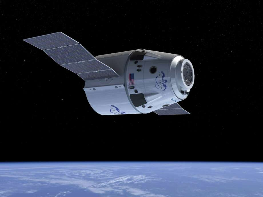 This undated computer generated illustration provided by SpaceX shows a Dragon Crew spacecraft in Earth orbit showing solar panels in the process of deploying. NASA has picked three aerospace companies to build small rocketships to take astronauts to the International Space Station. This is the third phase of NASA's efforts to get private space companies to take over the job of the now-retired space shuttle. The space agency is giving them more than $1.1 billion. Two of three ships are capsules like in the Apollo era and the third is a lifting body that is closer in design to the space shuttle. (AP Photo/SpaceX) Photo: Associated Press / SpaceX