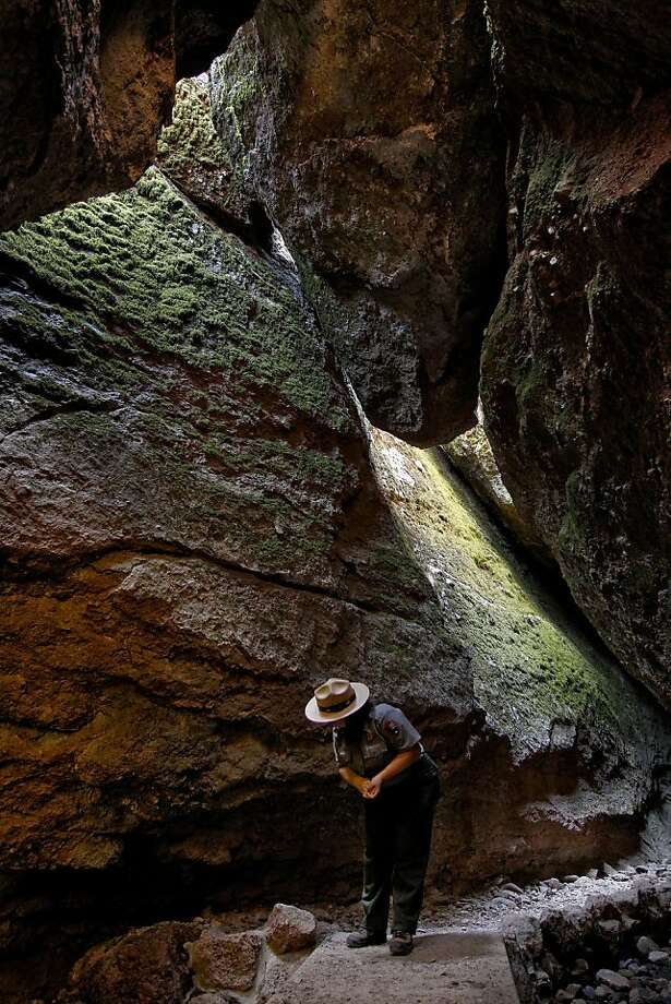 Nicole Andler, interim park superintendent at Pinnacles National Monument, looks around Bear Gulch Cave, which is home to a colony of big-eared bats. Photo: Michael Macor, The Chronicle