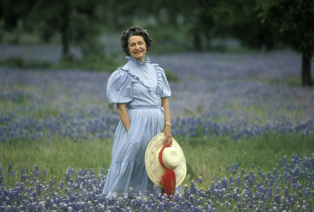 Lady Bird Johnson, posing among the wildflowers at the LBJ Ranch, devoted much of her life to protecting the environment.
