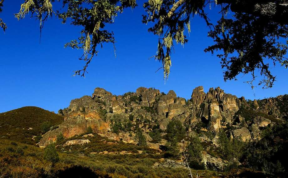 The west side of the popular High Peaks trail at Pinnacles National Monument shows the park's colorful terrain, the result of a volcanic field. More than 30 miles of trails grace the rugged landscape. Photo: Michael Macor, The Chronicle