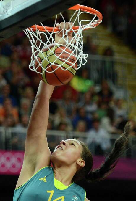 Australia's Liz Cambage makes unofficial Olympic history as the first woman to dunk during the women's tournament. The Aussies went on to defeat the Silvers Stars' Becky Hammon and Russia. Photo: TIMOTHY A. CLARY, AFP/Getty Images / AFP