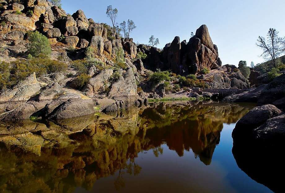 Pinnacles National ParkCalifornia's newest national park – it was incorporated as the 59th U.S. national park in 2013 – remains altogether under-the-radar. But with recent upgrades and more than 26,000 acres, there's plenty to see and explore. Caves, condors, wildflowers, waterfalls and craggy mountains are just some of the highlights at this park located about 130 miles south of San Francisco. Photo: Michael Macor, The Chronicle
