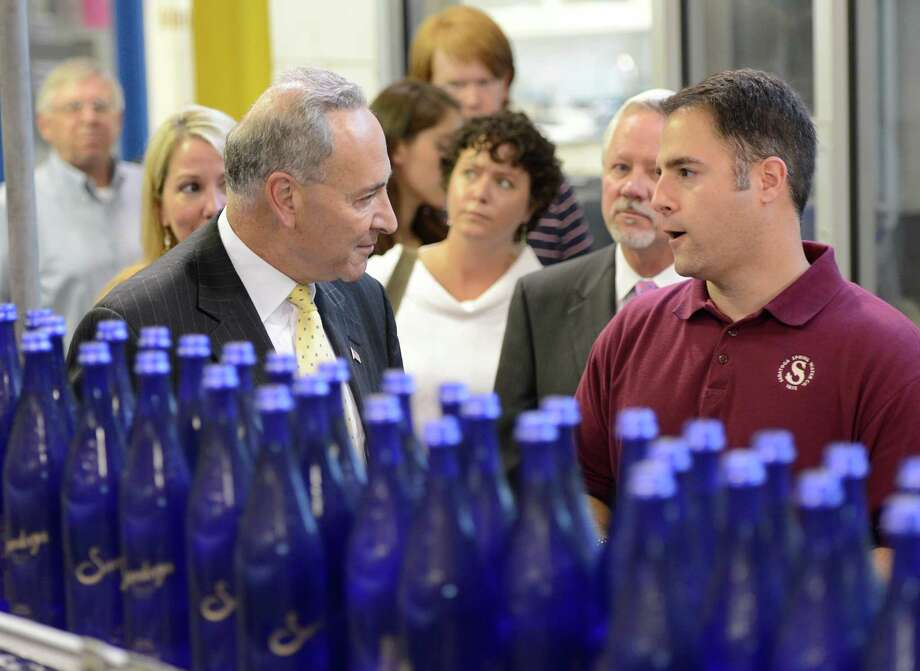 Adam Madkour, right COO of Saratoga Spring Water Company gives Senator Charles Schumer a full tour of the bottling plant in Saratoga Springs, N.Y. Aug 2, 2012.   (Skip Dickstein/Times Union) Photo: Skip Dickstein / 00018725A