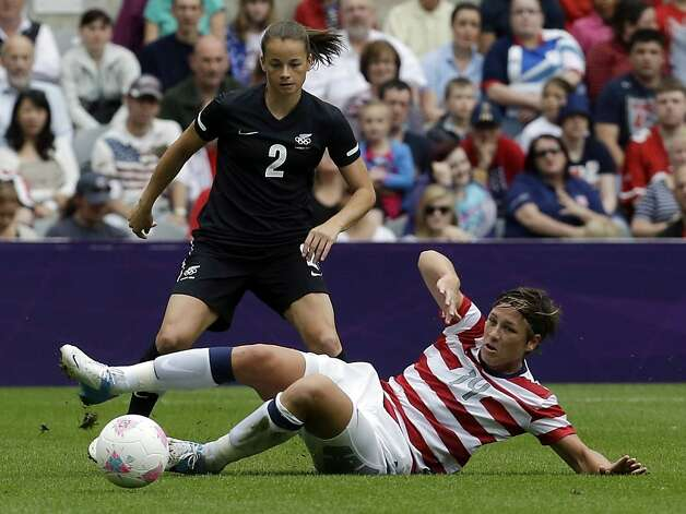 Abby Wambach protects her turf while battling New Zealand's Ria Percival for the ball in the Americans' 2-0 win. Photo: Sergey Ponomarev, Associated Press / SF