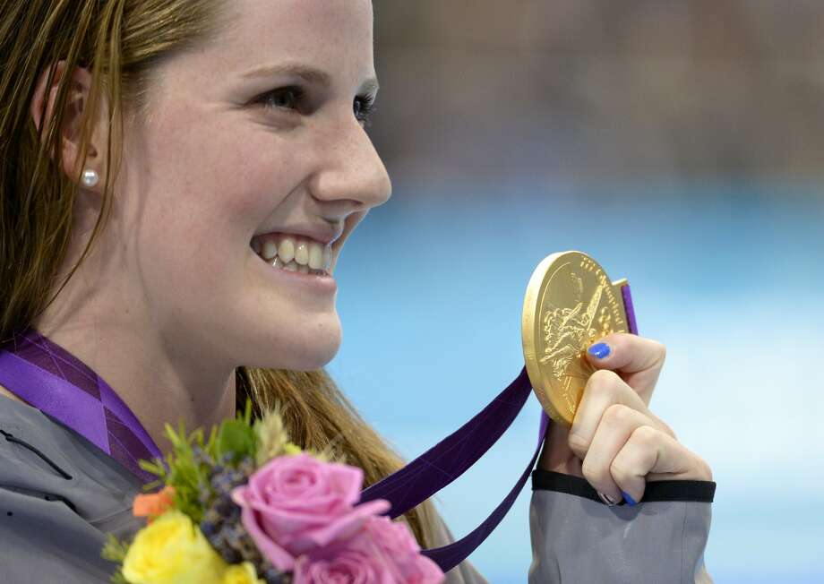 United States' Missy Franklin poses with her gold medal in the women's 200-meter backstroke final during the men's 50-meter freestyle final at the Aquatics Centre in the Olympic Park during the 2012 Summer Olympics in London, Friday, Aug. 3, 2012. (AP Photo/Mark J. Terrill) (Mark J. Terrill / Associated Press)