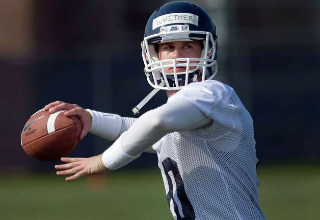 Connecticut quarterback Chandler Whitmer throws during the team's first NCAA college football practice of the season, in Storrs, Conn., Friday, Aug. 3, 2012. Connecticut opened practice Friday with Whitmer, a junior-college transfer, as the No. 1 quarterback on the depth chart. Whitmer got the nod this week on the strength of his performance in UConn's spring game, in which he completed 18 of 27 passes for 187 yards  (AP Photo/Jessica Hill) Photo: Jessica Hill, Associated Press / FR125654 AP