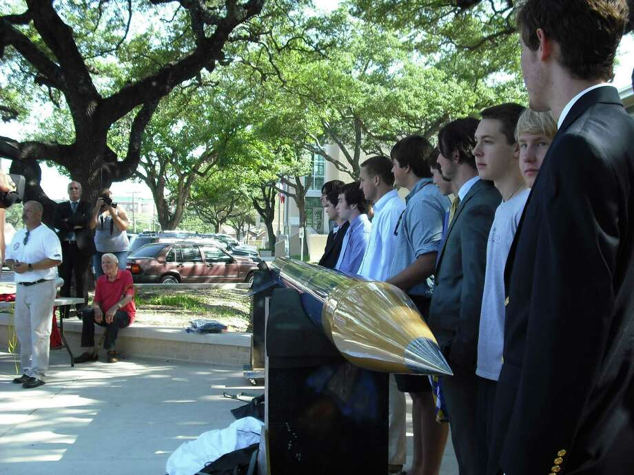 Alamo  Heights High   School aeroscience students invested close to $30,000 and more than 1,000 hours to build their 22-foot-tall, 600-pound rocket. Photo: Kin Man Hui, San Antonio Express-News