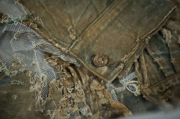 A cuff and button on the sleeve of the world's oldest denim jacket, dating to the 1880s, at Levi's headquarters. Photo: Yue Wu, The Chronicle