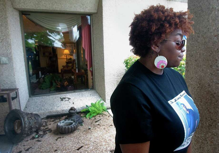 Shattered glass and broken pottery show where mourners threw out a man they thought was intruding on Friday's funeral for  Jasmine Davis' brother-in-law, Claude Kibbie, in northwest Houston. Photo: Cody Duty / © 2011 Houston Chronicle