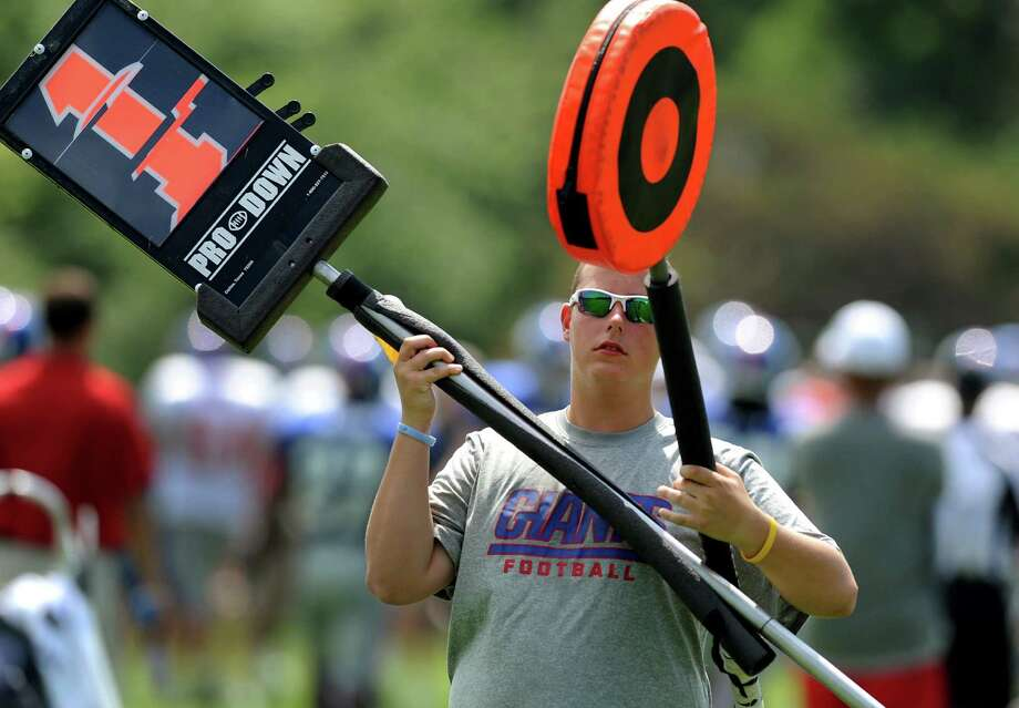 A volunteer moves the chains during New York Giants training camp on Friday, Aug. 3, 2012, at the UAlbany in Albany, N.Y. (Cindy Schultz / Times Union) Photo: Cindy Schultz / 00018640A