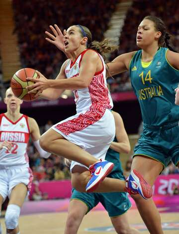 Russian guard Becky Hammon (L) goes for a basket next to Australian center Elizabeth Cambage during the women's preliminary round group A basketball match of the London 2012 Olympic Games Russia vs. Australia on August 3, 2012 at the basketball arena in London. Australia won 70 to 66.  AFP PHOTO / MARK RALSTONMARK RALSTON/AFP/GettyImages (MARK RALSTON / AFP/Getty Images)