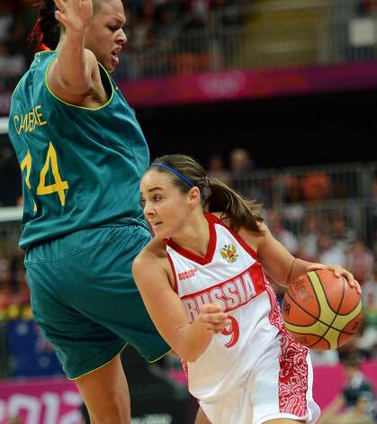 Russian guard Becky Hammon (R) vies with Australian center Elizabeth Cambage during the women's preliminary round group A basketball match of the London 2012 Olympic Games Russia vs. Australia on August 3, 2012 at the basketball arena in London. AFP PHOTO / TIMOTHY A. CLARYTIMOTHY A. CLARY/AFP/GettyImages (TIMOTHY A. CLARY / AFP/Getty Images)