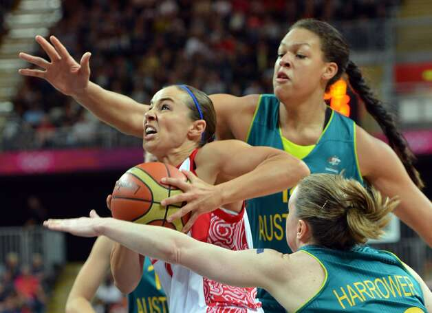 Russian guard Becky Hammon (L) vies with Australian center Elizabeth Cambage  during the women's preliminary round group A basketball match of the London 2012 Olympic Games Russia vs. Australia on August 3, 2012 at the basketball arena in London. Australia won 70 to 66.  AFP PHOTO / MARK RALSTONMARK RALSTON/AFP/GettyImages (MARK RALSTON / AFP/Getty Images)