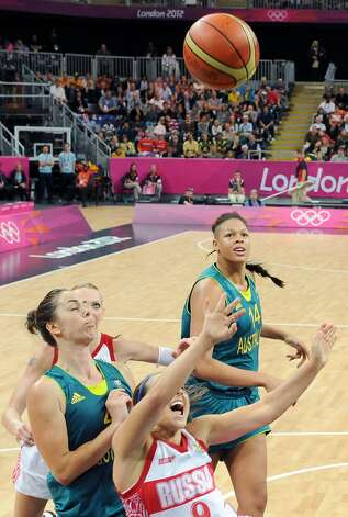Russia's Becky Hammon, center, scores against Australia during their preliminary women's basketball game at the 2012 Summer Olympics, Friday, Aug. 3, 2012, in London. (AP Photo/Mark Ralston, Pool) (Mark Ralston / Associated Press)
