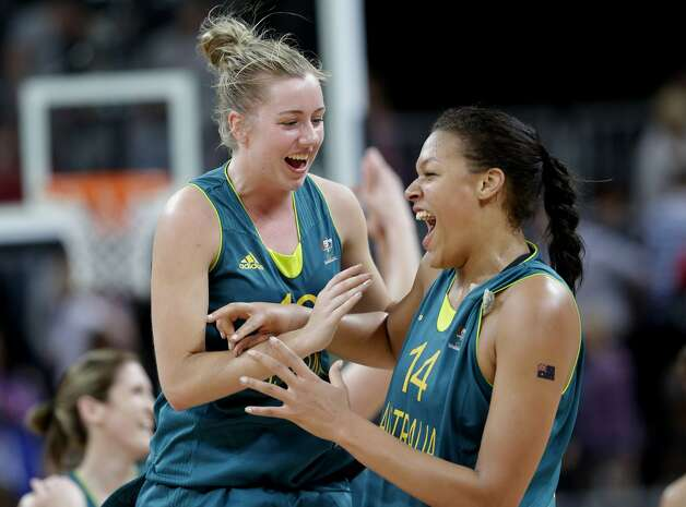Australia's Rachel Jarry, left, and Australia's Elizabeth Cambage, right, celebrate their win over Russia in a preliminary women's basketball game at the 2012 Summer Olympics, Friday, Aug. 3, 2012, in London. (AP Photo/Eric Gay) (Eric Gay / Associated Press)