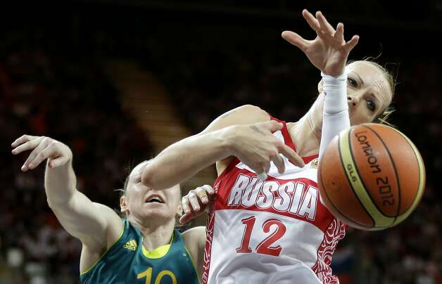 Australia's Kristi Harrower, left, knocks the ball away from Russia's Irina Osipova (12) during a preliminary women's basketball game at the 2012 Summer Olympics, Friday, Aug. 3, 2012, in London. (AP Photo/Eric Gay) (Eric Gay / Associated Press)