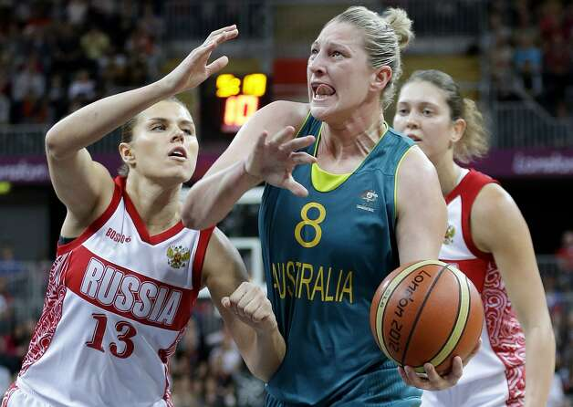 Australia's Suzy Batkovic (8) looks to shoot around Russia defender Anna Petrakova (13)during a preliminary women's basketball game at the 2012 Summer Olympics, Friday, Aug. 3, 2012, in London. (AP Photo/Eric Gay) (Eric Gay / Associated Press)