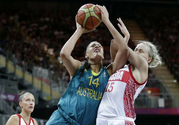 Australia's Elizabeth Cambage (14) is drives to the basket as Russia's Nadezhda Grishaeva (15) defends during a preliminary women's basketball game at the 2012 Summer Olympics, Friday, Aug. 3, 2012, in London. (AP Photo/Eric Gay) (Eric Gay / Associated Press)