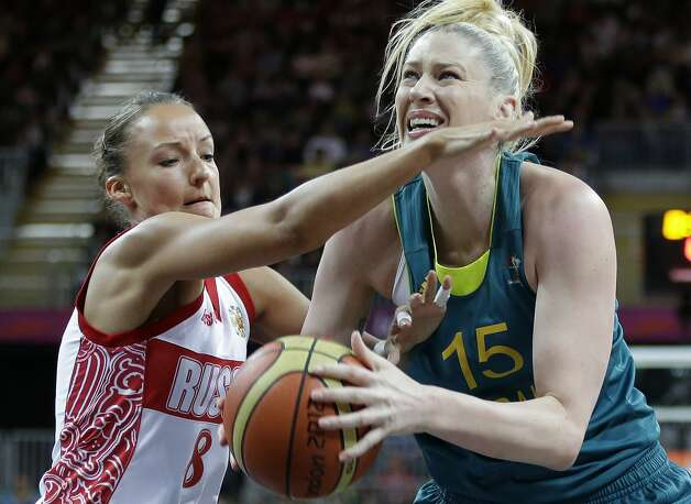 Russia's Alena Danilochkina (8) pressures Australia's Lauren Jackson (15) during a preliminary women's basketball game at the 2012 Summer Olympics, Friday, Aug. 3, 2012, in London. (AP Photo/Eric Gay) (Eric Gay / Associated Press)