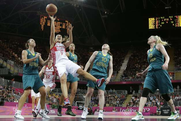 Russia's Becky Hammon (9) falls back as she shoots against Australia during a preliminary women's basketball game at the 2012 Summer Olympics, Friday, Aug. 3, 2012, in London. (AP Photo/Eric Gay) (Eric Gay / Associated Press)