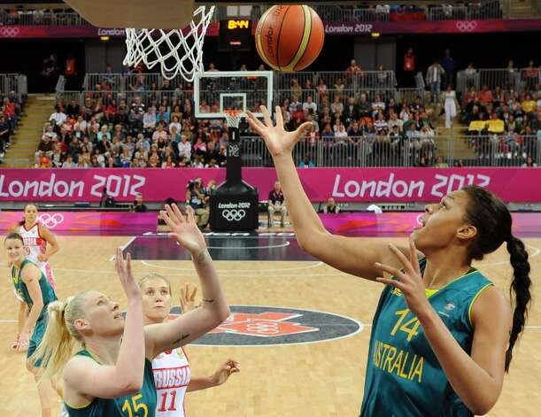 Australia center Elizabeth Cambage (14) shoots to score against Russia during their preliminary women's basketball game at the 2012 Summer Olympics, Friday, Aug. 3, 2012, in London. (AP Photo/Mark Ralston, Pool) (Mark Ralston / Associated Press)