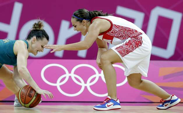 Australia's Jennifer Screen, left, and Russia's Becky Hammon, right, chase a loose ball during a preliminary women's basketball game at the 2012 Summer Olympics, Friday, Aug. 3, 2012, in London. (AP Photo/Eric Gay) (Eric Gay / Associated Press)