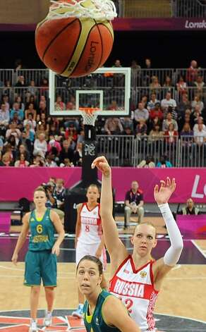Russia's Irina Osipova (12) shoots to score against Australia during their preliminary women's basketball game at the 2012 Summer Olympics, Friday, Aug. 3, 2012, in London. (AP Photo/Mark Ralston, Pool) (Mark Ralston / Associated Press)