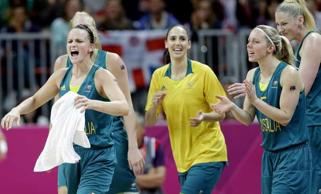 Members of the Australia women's basketball team celebrate their win over Russia in their preliminary women's basketball game at the 2012 Summer Olympics, Friday, Aug. 3, 2012, in London. (AP Photo/Eric Gay) (Eric Gay / Associated Press)