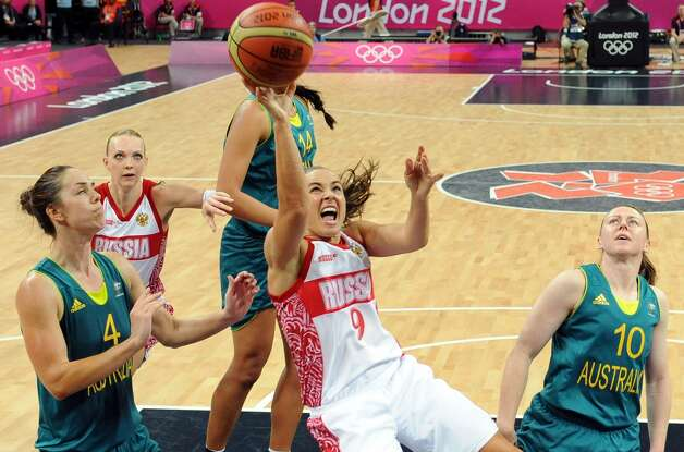 Russia's Becky Hammon (9) scores against Australia during their preliminary women's basketball game at the 2012 Summer Olympics, Friday, Aug. 3, 2012, in London. (AP Photo/Mark Ralston, Pool) (Mark Ralston / Associated Press)