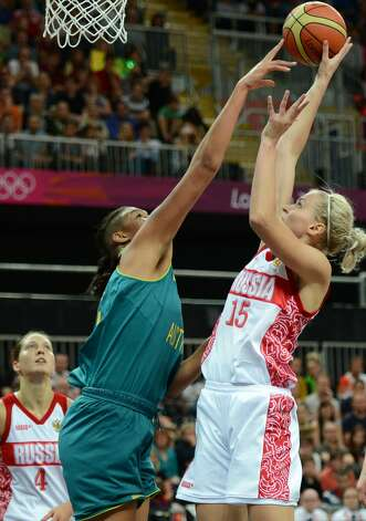 Australian center Elizabeth Cambage (L) vies with Russia's Nadezhda Grishaeva during the women's preliminary round group A basketball match of the London 2012 Olympic Games Russia vs. Australia on August 3, 2012 at the basketball arena in London. AFP PHOTO / TIMOTHY A. CLARYTIMOTHY A. CLARY/AFP/GettyImages (TIMOTHY A. CLARY / AFP/Getty Images)