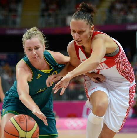 Russian forward Marina Kuzina (R) vies with Australian forward Rachel Jarry during the women's preliminary round group A basketball match of the London 2012 Olympic Games Russia vs. Australia on August 3, 2012 at the basketball arena in London. AFP PHOTO / TIMOTHY A. CLARYTIMOTHY A. CLARY/AFP/GettyImages (TIMOTHY A. CLARY / AFP/Getty Images)