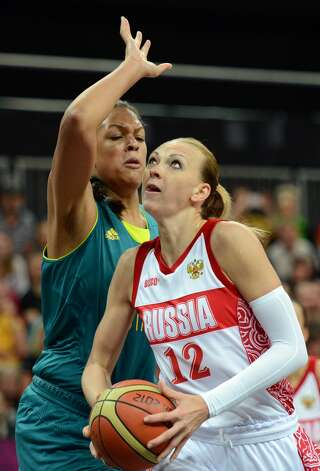 Russian centre Irina Osipova (R) vies with Australian center Elizabeth Cambage during the women's preliminary round group A basketball match of the London 2012 Olympic Games Russia vs. Australia on August 3, 2012 at the basketball arena in London. AFP PHOTO / TIMOTHY A. CLARYTIMOTHY A. CLARY/AFP/GettyImages (TIMOTHY A. CLARY / AFP/Getty Images)