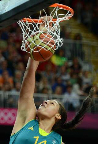 Australian center Elizabeth Cambage scores a basket during the women's preliminary round group A basketball match of the London 2012 Olympic Games Russia vs. Australia on August 3, 2012 at the basketball arena in London. AFP PHOTO / TIMOTHY A. CLARYTIMOTHY A. CLARY/AFP/GettyImages (TIMOTHY A. CLARY / AFP/Getty Images)