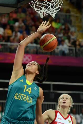 Australian center Elizabeth Cambage (L) scores a basket eyed by Russian centre Nadezhda Grishaeva during the women's preliminary round group A basketball match of the London 2012 Olympic Games Russia vs. Australia on August 3, 2012 at the basketball arena in London. AFP PHOTO / TIMOTHY A. CLARYTIMOTHY A. CLARY/AFP/GettyImages (TIMOTHY A. CLARY / AFP/Getty Images)