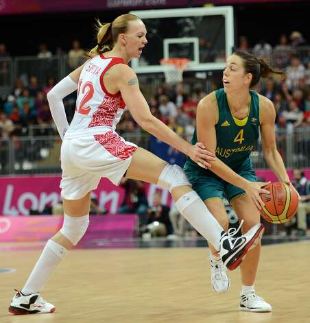 Russian centre Irina Osipova (L) vies with Australian forward Jenna O'Hea during the women's preliminary round group A basketball match of the London 2012 Olympic Games Russia vs. Australia on August 3, 2012 at the basketball arena in London. AFP PHOTO / TIMOTHY A. CLARYTIMOTHY A. CLARY/AFP/GettyImages (TIMOTHY A. CLARY / AFP/Getty Images)