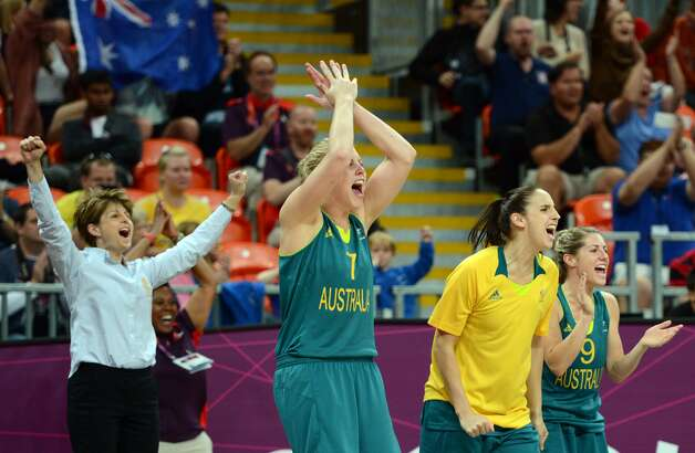 Australia's plays celebrate a basket during the women's preliminary round group A basketball match of the London 2012 Olympic Games Russia vs. Australia on August 3, 2012 at the basketball arena in London. AFP PHOTO / TIMOTHY A. CLARYTIMOTHY A. CLARY/AFP/GettyImages (TIMOTHY A. CLARY / AFP/Getty Images)