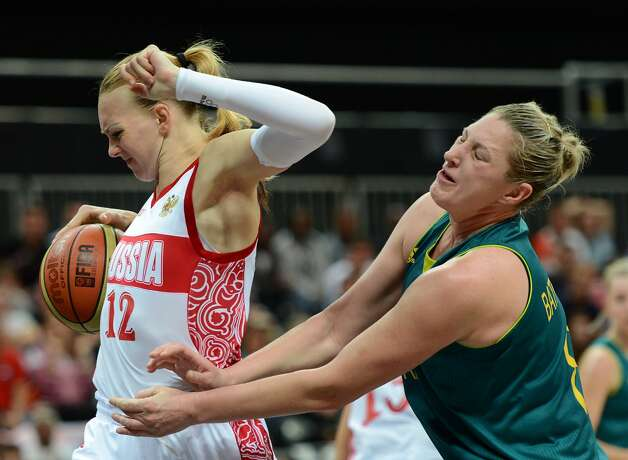 Australian center Suzy Batkovic (R) vies with Russian centre Irina Osipova during the women's preliminary round group A basketball match of the London 2012 Olympic Games Russia vs. Australia on August 3, 2012 at the basketball arena in London. AFP PHOTO / TIMOTHY A. CLARYTIMOTHY A. CLARY/AFP/GettyImages (TIMOTHY A. CLARY / AFP/Getty Images)