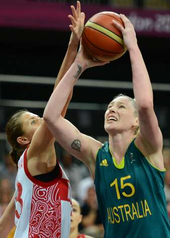 Russian forward Anna Petrakova (L) vies with Australian centre Lauren Jackson during the women's preliminary round group A basketball match of the London 2012 Olympic Games Russia vs. Australia on August 3, 2012 at the basketball arena in London. AFP PHOTO / TIMOTHY A. CLARYTIMOTHY A. CLARY/AFP/GettyImages (TIMOTHY A. CLARY / AFP/Getty Images)
