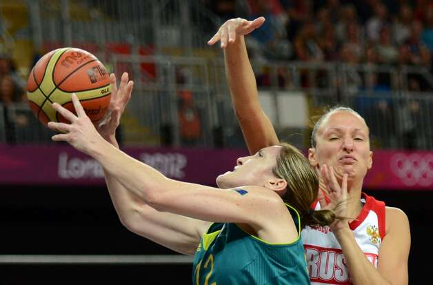 Australian guard Belinda Snell (L) vies with Russian forward Marina Kuzina  during the women's preliminary round group A basketball match of the London 2012 Olympic Games Russia vs. Australia on August 3, 2012 at the basketball arena in London. AFP PHOTO / TIMOTHY A. CLARYTIMOTHY A. CLARY/AFP/GettyImages (TIMOTHY A. CLARY / AFP/Getty Images)
