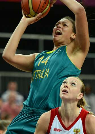 Russian centre Irina Osipova (R) looks at Australian center Elizabeth Cambage going for a basket during the women's preliminary round group A basketball match of the London 2012 Olympic Games Russia vs. Australia on August 3, 2012 at the basketball arena in London. AFP PHOTO / TIMOTHY A. CLARYTIMOTHY A. CLARY/AFP/GettyImages (TIMOTHY A. CLARY / AFP/Getty Images)