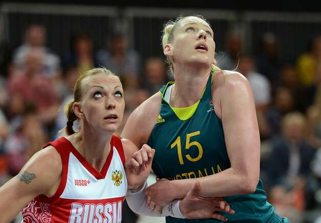 Russian centre Irina Osipova (L) vies with Australian centre Lauren Jackson during the women's preliminary round group A basketball match of the London 2012 Olympic Games Russia vs. Australia on August 3, 2012 at the basketball arena in London. AFP PHOTO / TIMOTHY A. CLARYTIMOTHY A. CLARY/AFP/GettyImages (TIMOTHY A. CLARY / AFP/Getty Images)