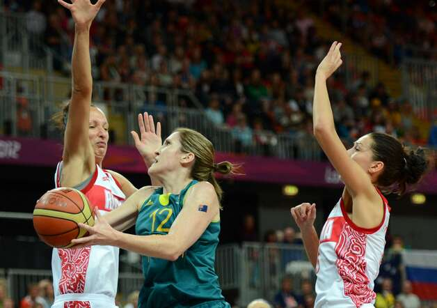 Russian centre Irina Osipova (L) vies with Australian guard Belinda Snell (C) during the women's preliminary round group A basketball match of the London 2012 Olympic Games Russia vs. Australia on August 3, 2012 at the basketball arena in London. AFP PHOTO / TIMOTHY A. CLARYTIMOTHY A. CLARY/AFP/GettyImages (TIMOTHY A. CLARY / AFP/Getty Images)