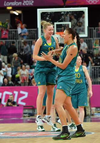 Australian players celebrate at the end of the women's preliminary round group A basketball match of the London 2012 Olympic Games Russia vs. Australia on August 3, 2012 at the basketball arena in London. Australia won 70 to 66.  AFP PHOTO / MARK RALSTONMARK RALSTON/AFP/GettyImages (MARK RALSTON / AFP/Getty Images)