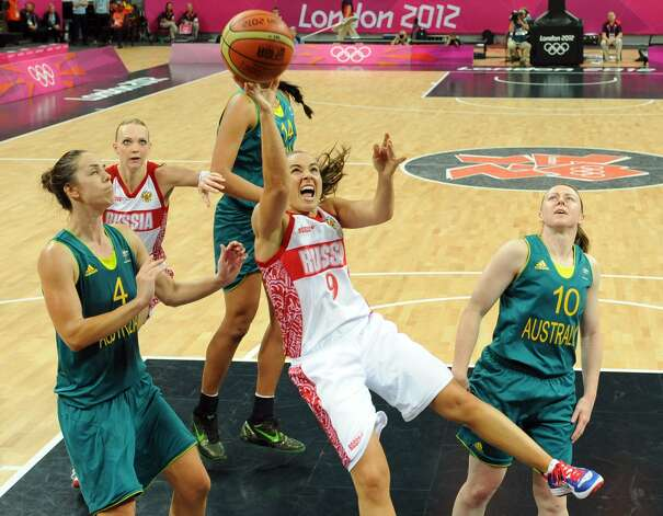 Russian guard Becky Hammon (C) scores a basket during the women's preliminary round group A basketball match of the London 2012 Olympic Games Russia vs. Australia on August 3, 2012 at the basketball arena in London. Australia won 70 to 66.  AFP PHOTO / MARK RALSTONMARK RALSTON/AFP/GettyImages (MARK RALSTON / AFP/Getty Images)