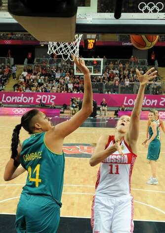 Russian centre Natalya Vieru (R) tries to score a basket despite Australian center Elizabeth Cambage (L) during the women's preliminary round group A basketball match of the London 2012 Olympic Games Russia vs. Australia on August 3, 2012 at the basketball arena in London. Australia won 70 to 66.  AFP PHOTO POOL/ MARK RALSTONMARK RALSTON/AFP/GettyImages (MARK RALSTON / AFP/Getty Images)